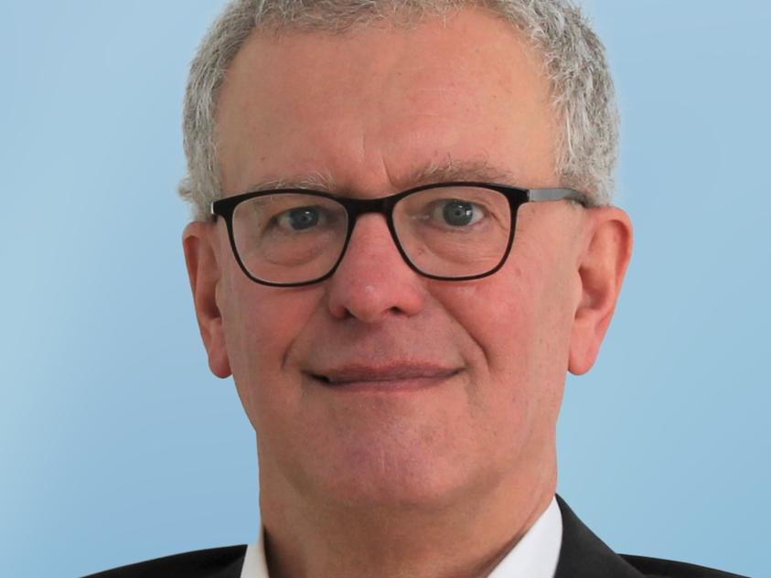 Dr. Karl Kreuser